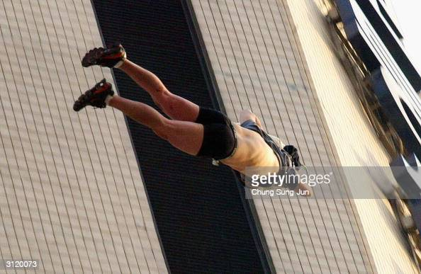 South Korean man attempts to commit suicide by jumping off of a highrise building near the US embassy after demanding he be sent to the United States...