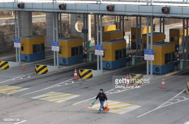 South Korean man cleaning at empty road connection Kaesong Industrial Complex with South's CIQ at interKorean transit office in Paju on April 4 2013...