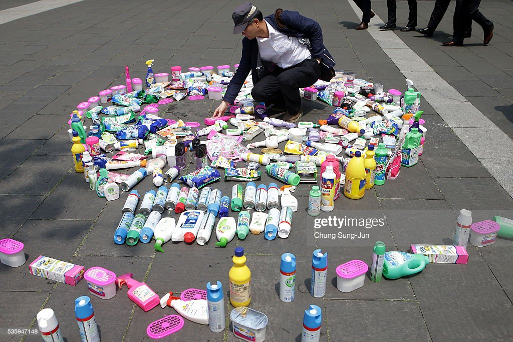 A South Korean man collect Oxy goods on May 31, 2016 in Seoul, South Korea. Protesters hold a anti-Oxy Reckitt Benckiser rally to launch a boycott campaign against the British firm's products in front of Oxy headquarter in South Korea.