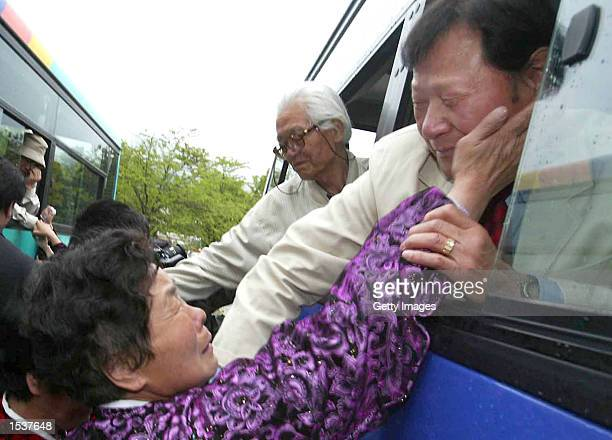 South Korean man cries as he says goodbye to his North Korean relative April 30 2002 at North Korea's Mount Kumgang resort Ninetynine South Koreans...