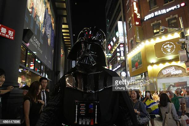 South Korean man dressed in a Darth Vader during the 'Star Wars Force Friday' in Myeongdong shopping district on September 4 2015 in Seoul South...