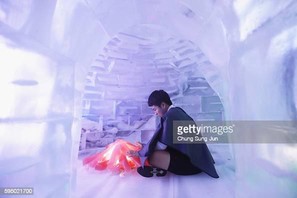 South Korean man enjoy at the 'Ice Museum' on August 25 2016 in Seoul South Korea In Seoul's 'Ice Museum' people enjoyed the minus 10 degrees Celsius...