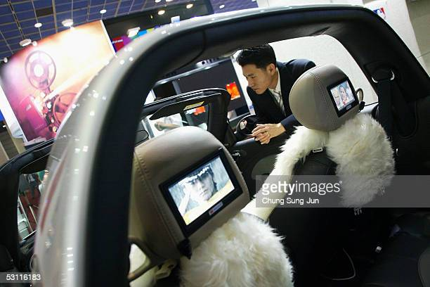 South Korean man looks at a technologically advanced car on June 22 2005 in Seoul South Korea South Korea's Ministry of Information and Communication...