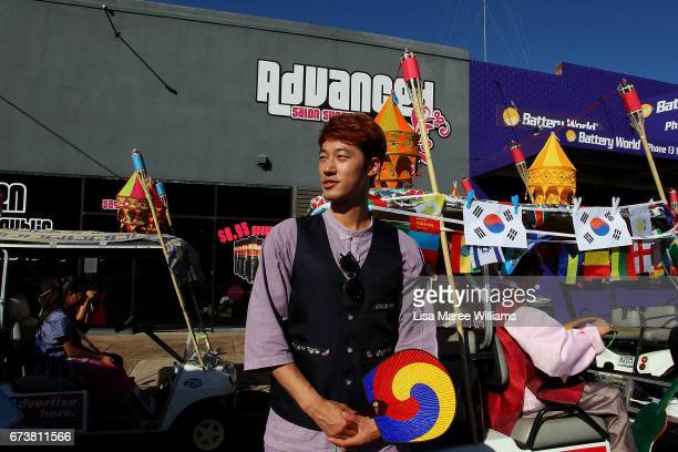 South Korean man prepares to make his way along Peel Street during the annual Tamworth Country Music Festival Cavalcade on January 28 2017 in...
