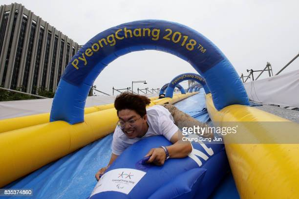 South Korean man slides down on an inflatable bobsleigh during the 'Bobsleigh In the City' on August 19 2017 in Seoul South Korea The 22metrehigh...