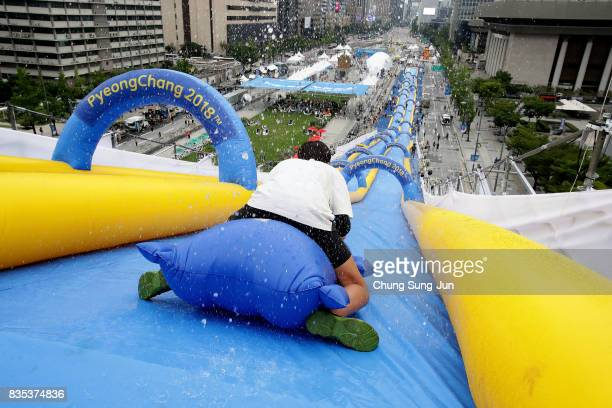 South Korean man slides down on an inflatable during the 'Bobsleigh In the City' on August 19 2017 in Seoul South Korea The 22metrehigh 300metrelong...