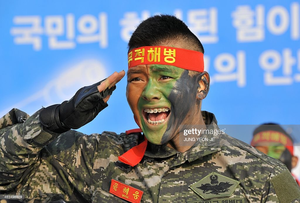A South Korean marine salutes as he performs military arts during a ceremony to commemorate the third anniversary of North Korea's shelling of...