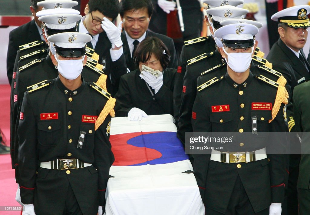 South Korean Marines carry a flag-draped casket containing the remains of one of the two marines killed in a North Korean artillery barrage on the South Korean border island Yeonpyeong during a funeral service at a military hospital on November 27, 2010 in Seongnam, South Korea. North Korea fired a barrage of artillery at the border Island November 23, 2010, killing four people.