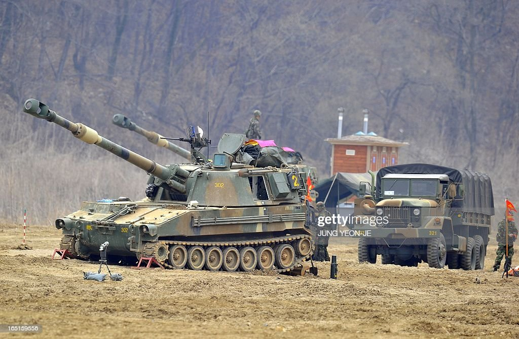 South Korean marines man K-55 self-propelled howitzers at a military training field in the border city of Paju on on April 1, 2013. South Korea's new president on April 1 promised a strong military response to any North Korean provocation after Pyongyang announced that the two countries were now in a state of war.