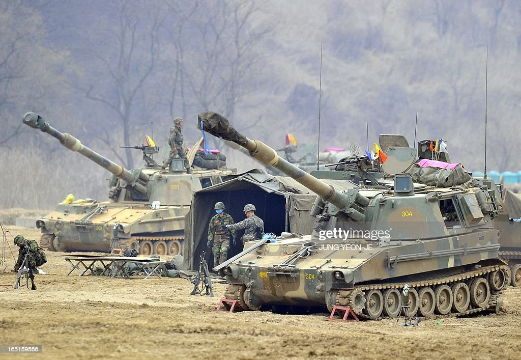 South Korean marines man K-55 self-propelled howitzers at a military training field in the border city of Paju on on April 1, 2013. South Korea's new president on April 1 promised a strong military response to any North Korean provocation after Pyongyang announced that the two countries were now in a state of war. AFP PHOTO / JUNG YEON-JE
