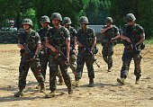 South Korean marines move after a demonstration during a press tour to General Outpost of 2nd Marine Division at a military base in Gimpo near the...