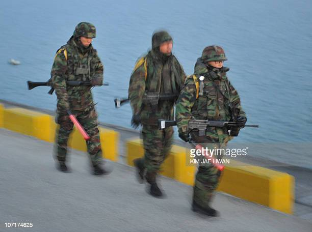 South Korean Marines patrol along the seashore on Yeonpyeong Island on November 28 2010 five days after the North stunned the world by launching a...