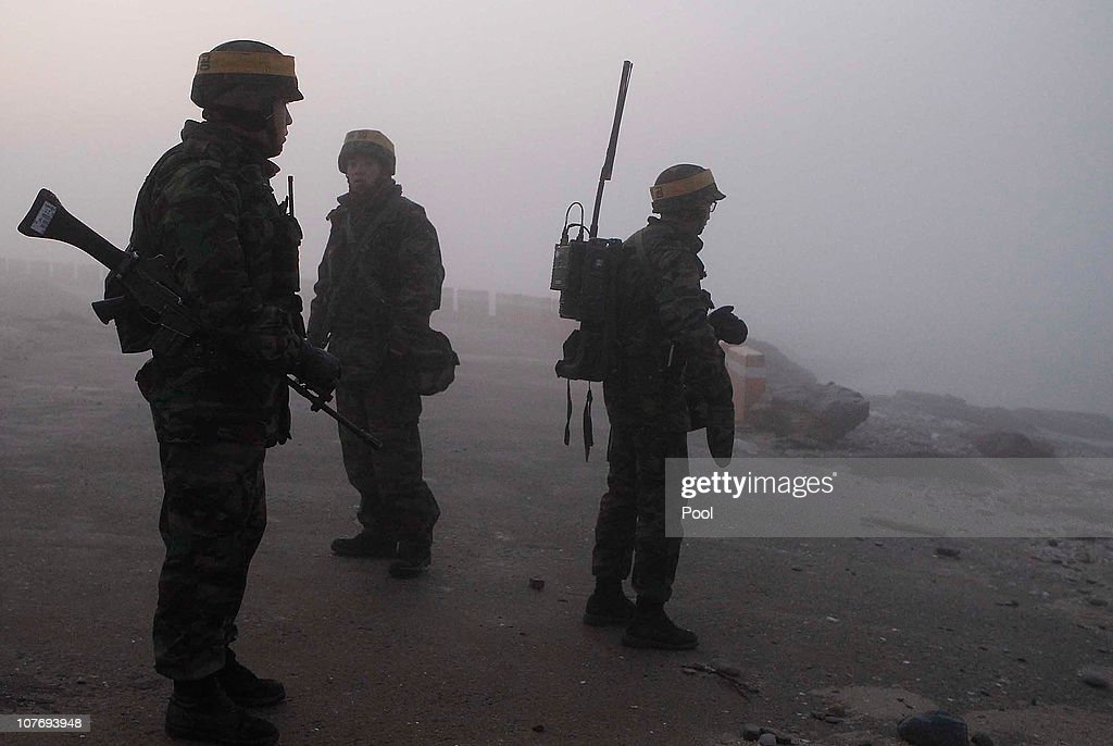 South Korean marines patrol on December 20 2010 in Yeonpyeong Island South Korea South Korea held livefiring drills on the island of Yeonpyeong which...
