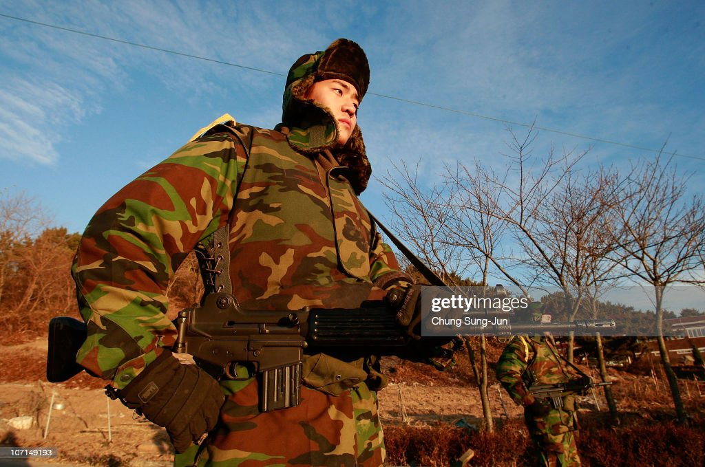 South Korean marines patrol on Yeonpyeong Island on November 26 2010 in Yeonpyeong Island South Korea South Korean Prime Minister Lee Myungbak...