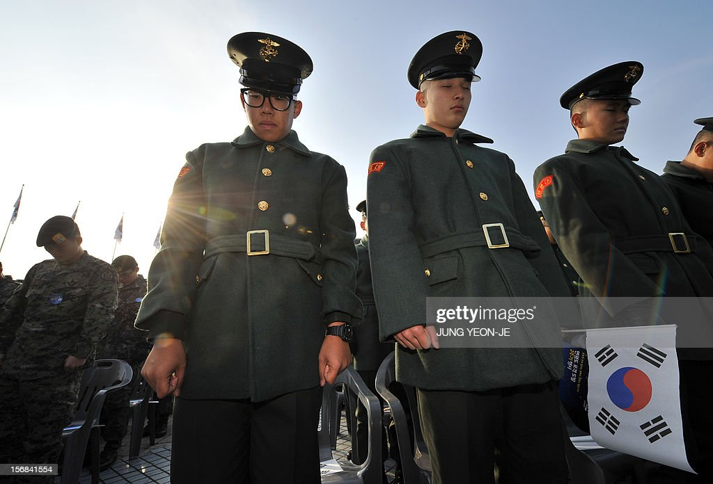 South Korean marines pay a silent tribute to their fallen comrades killed by North Korea's 2010 attack during a ceremony to commemorate the second anniversary of North Korea's shelling of Yeonpyeong Island at the War Memorial in Seoul on November 23, 2012. The November 23, 2010 attack on Yeonpyeong island killed two South Korean marines and two civilians in one of the most serious border incidents since the 1950-1953 Korean War. AFP PHOTO / JUNG YEON-JE