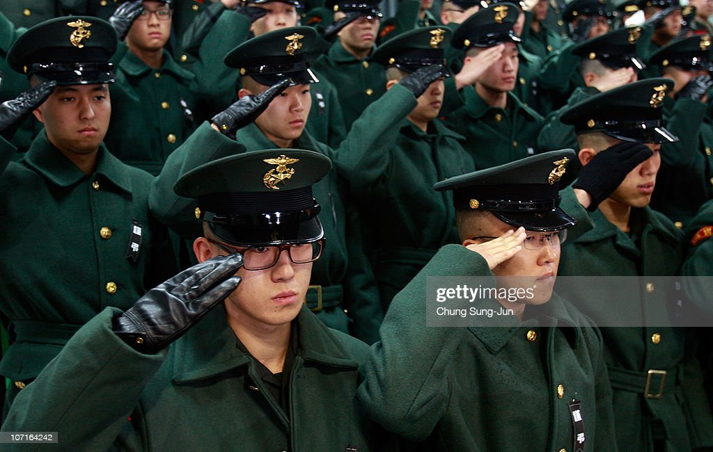 South Korean marines salute during a funeral service for the marines who were killed in a North Korean artillery barrage on the South Korean border...