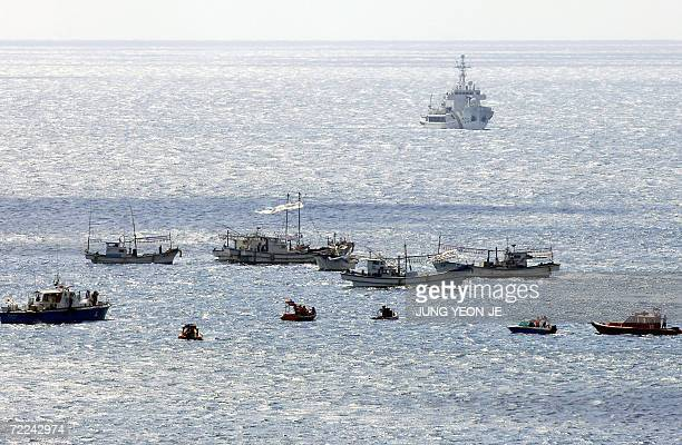 South Korean maritime police use patrol ships and rubber boats to intercept fishing boats carrying activists off the beachside hotel where...