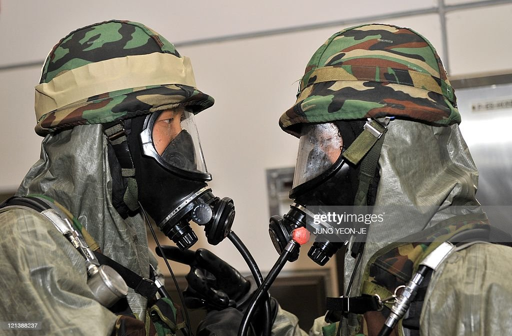 South Korean military biochemical warfare soldiers talk during an antiterror drill as part of a joint USSouth Korean exercise called 'Ulchi Freedom...