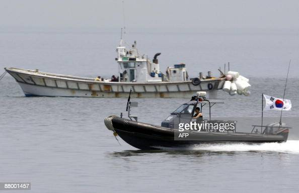 A South Korean military boat powers out of its sea base off Yeonpyeong Island in disputed waters in the Yellow Sea the scene of previous interKorean...