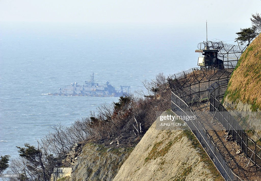 A South Korean military guard post is seen as a Navy MSB floats in the background at the South Koreacontrolled island of Yeonpyeong near the disputed...