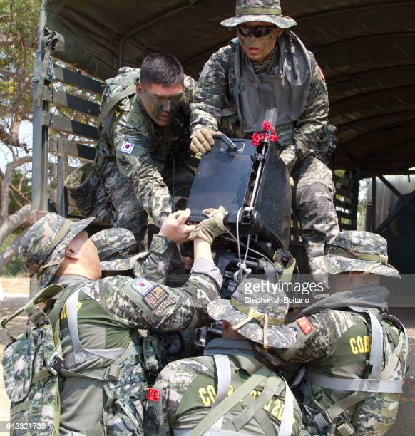 SATTAHIP CHONBURI THAILAND South Korean military load a boat engine on the beach head during the ongoing USThai joint military exercise titled 'Cobra...