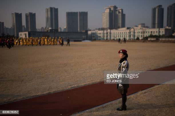 A South Korean military police officer stands guard prior to US Defense Secretary James Mattis attending an honour guard ceremony with his South...
