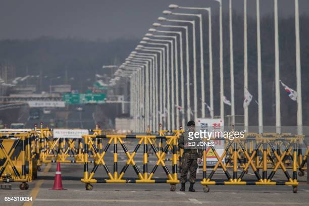 A South Korean military policeman stands at a checkpoint on the Tongil bridge the entrance to the Panmunjom Joint Security Area near the...