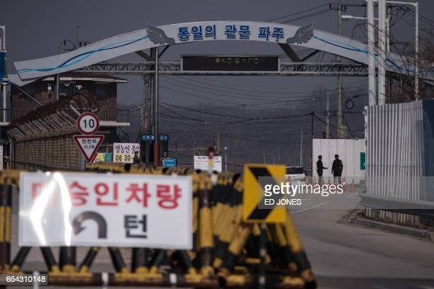 South Korean military policemen stand at a checkpoint on the Tongil bridge the entrance to the Panmunjom Joint Security Area near the Demilitarized...