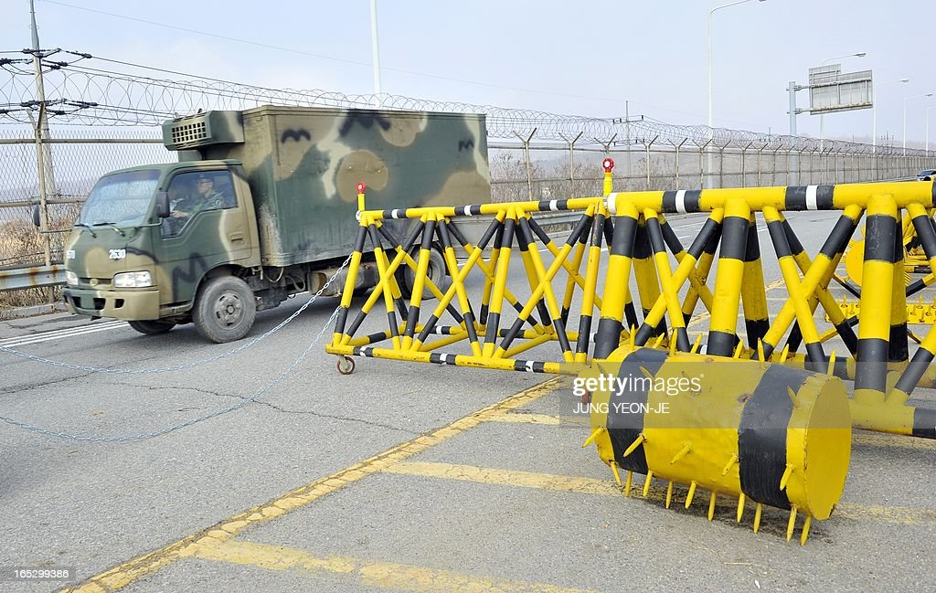 A South Korean military truck drives past barricades on the road linked to North Korea at a military check point in Paju near the demilitarized zone (DMZ) dividing the two Koreas on April 3, 2013. North Korea on April 3 delayed the entry of South Koreans to a joint industrial complex in a rare move amid high tensions on the Korean peninsula, the South's Unification Ministry said.