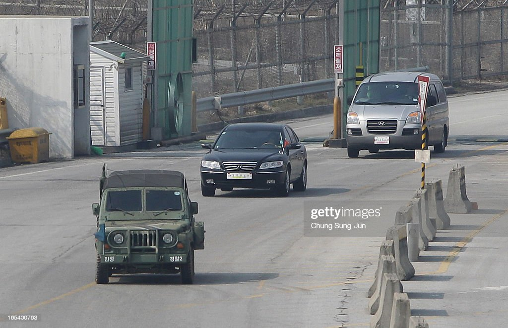A South Korean military vehicle leads cars from the Kaesong joint industrial complex in North Korea, at the inter-Korean transit office on April 4, 2013 in Paju, South Korea. 400 South Koreans remain in the joint industrial complex fearing they can not get back there once return to South. In recent weeks North Korea have threatened to attack South Korea and U.S. military bases.