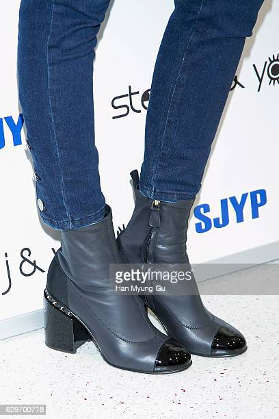 South Korean model Han HyeJin shoe detail attends the flagship store opening for 'Steve J and Yoni P' on December 14 2016 in Seoul South Korea