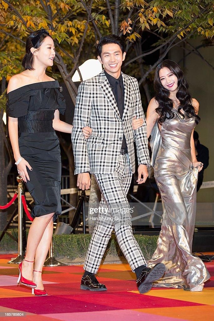 South Korean model Kang Seung-Hyon (Kang Seung-Hyun), Seulong of South Korean boy band 2AM and actress Clara attend 2013 Style Icon Awards at CJ E&M Center on October 24, 2013 in Seoul, South Korea.