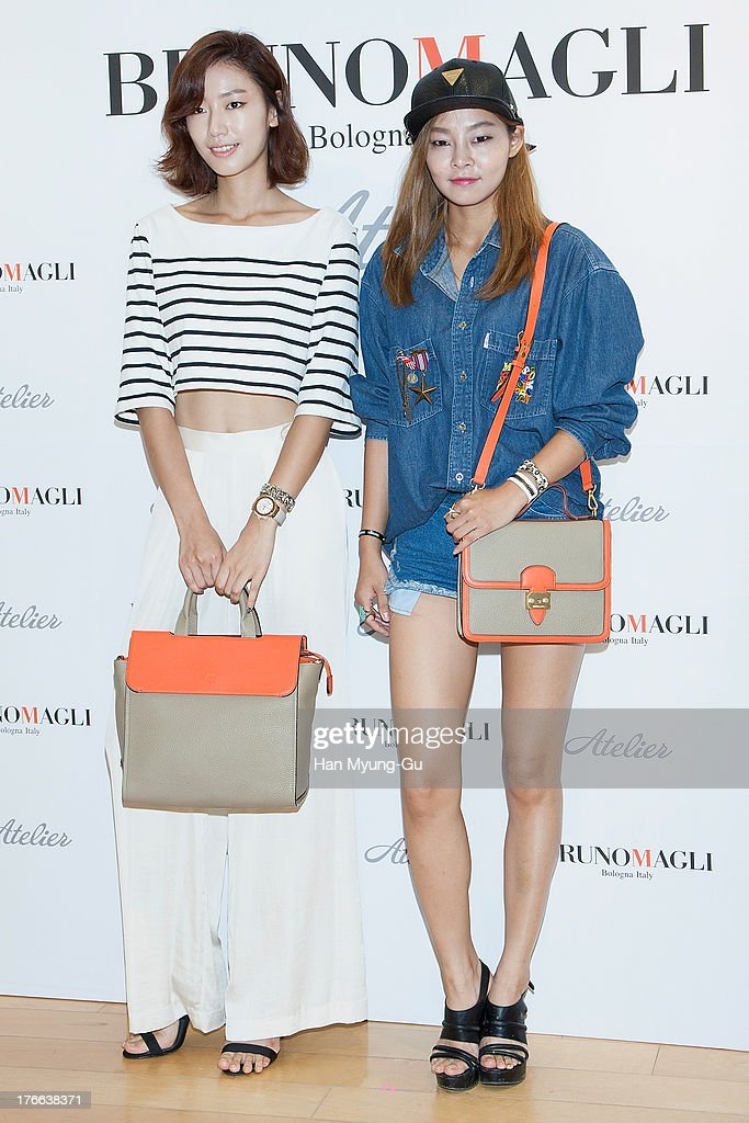 South Korean models Park Seul-Ki and Song Hae-Na attend during the 'Bruno Magli' atelier store grand opening in Seoul on August 16, 2013 in Seoul, South Korea.