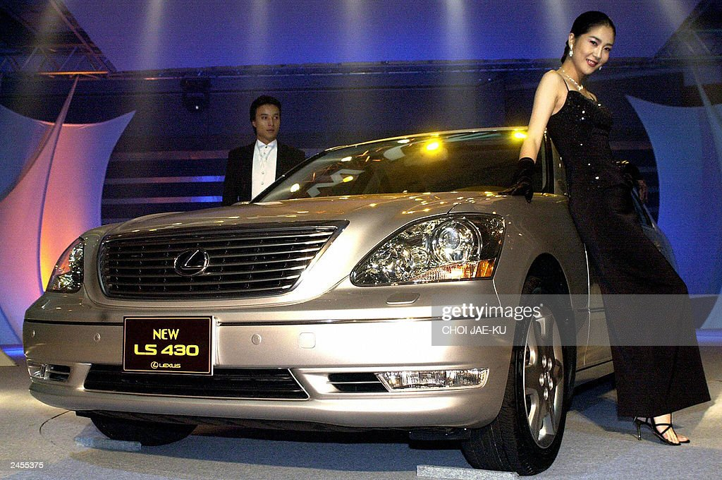 south korean models pose near a new lexus ls430 made by toyota from pictures getty images. Black Bedroom Furniture Sets. Home Design Ideas