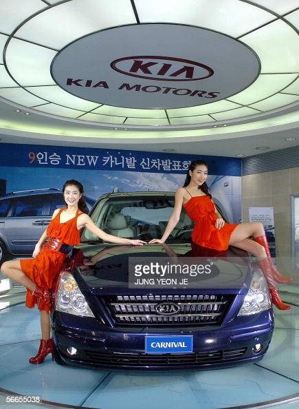 South korean models pose with kia motors pictures getty for Kia motors latest models