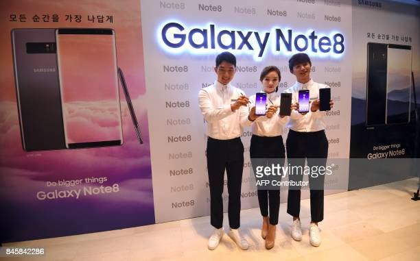 South Korean models show Samsung Galaxy Note8 devices during a showcase to mark the domestic launch of Samsung Electronics' latest flagship...