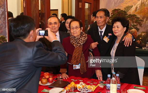 South Korean mother Kim WolSoon 93 poses for a souvenir photo with her North Korean son Ju JaeUn and other family members during the family reunion...
