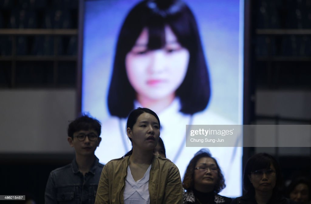 South Korean mourners weep after tribute at a group memorial altar for victims of sunken passengers ship at the Ansan Olympic Memorial Hall on April 23, 2014 in Ansan, South Korea. At the altar, Friends and relatives are able to pay tribute to those who have passed in the April 16 ferry disaster off of Jindo Island in South Korea. The confirmed death toll now reached 130, and more than 170 people are still missing, as reported.