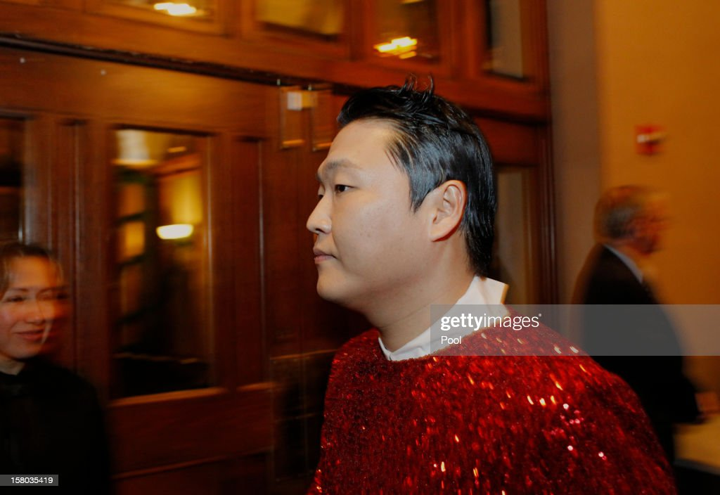 South Korean musician PSY walks backstage before performing in the 'Christmas in Washington' concert, attended by President Barack Obama, at the National Building Museum on December 9, 2012 in Washington, D.C. The concert benefits the National Childrens Medical Center and is hosted by comedian Conan O'Brien.