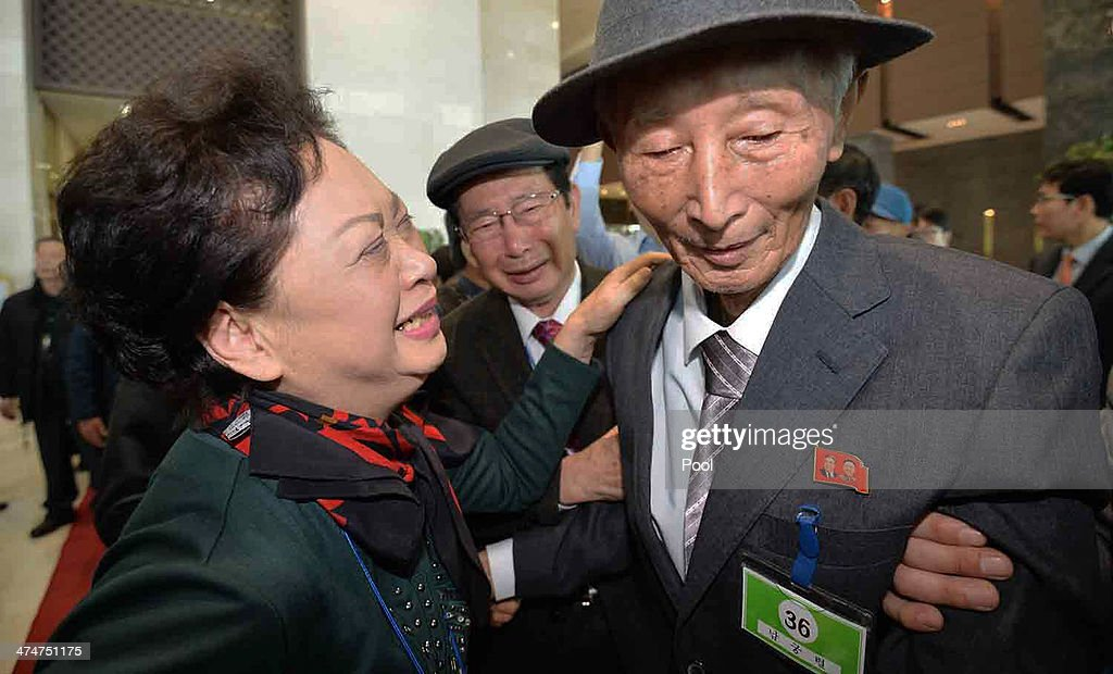 South Korean Nam Gung Bong-Ja (L) bids farewell to her North Korean father Nam Gung-Ryeol (R), 86, before they return to their home after a family reunion, having been separated for 60 years following the Korean War on February 25, 2014 in Mount Kumgang, North Korea. The program, which allows reunions of family members separated by the 1950-53 Korean war, is a result of recent agreement between Koreas which had been suspended since 2010.