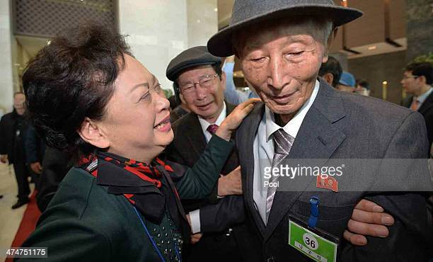 South Korean Nam Gung BongJa bids farewell to her North Korean father Nam GungRyeol before they return to their home after a family reunion having...