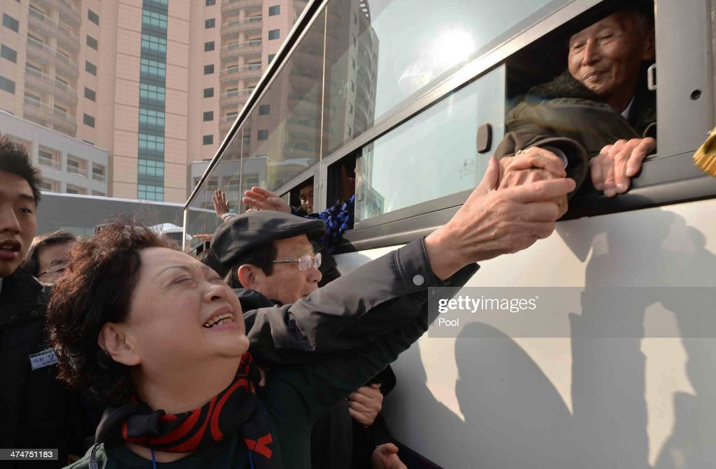 South Korean Nam Gung Bong-Ja (L) bids farewell to her North Korean father Nam Gung-Ryeol (R), 86, in a bus before they return to their home after a family reunion, having been separated for 60 years following the Korean War on February 25, 2014 in Mount Kumgang, North Korea. The program, which allows reunions of family members separated by the 1950-53 Korean war, is a result of recent agreement between Koreas which had been suspended since 2010.