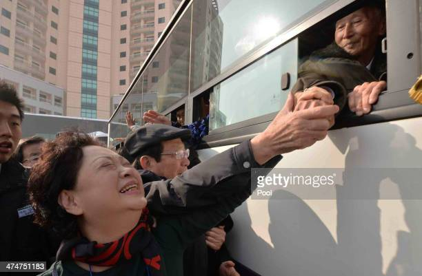 South Korean Nam Gung BongJa bids farewell to her North Korean father Nam GungRyeol in a bus before they return to their home after a family reunion...
