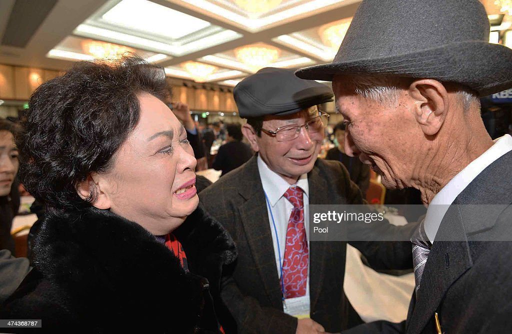 South Korean Nam Gung Bong-Ja (L) meets with her North Korean father Nam Gung Ryeol (R), 86, during a family reunion after being separated for 60 years on February 23, 2014 in Mount Kumgang, North Korea. The program, which allows reunions of family members separated by the 1950-53 Korean war, is a result of recent agreement between Koreas which had been suspended since 2010.