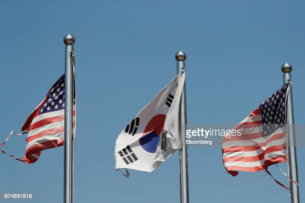 A South Korean national flag center and US national flags fly at the Imjingak pavilion near the demilitarized zone in Paju South Korea on Saturday...