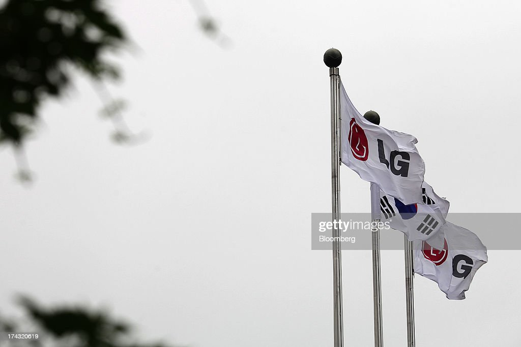 A South Korean national flag flies between two LG Corp. corporate flags outside the LG Twin Towers, which houses the company's subsidiaries including LG Electronics Inc., LG Display Co., LG Chem Ltd. and LG Household & Health Care Ltd., in Seoul, South Korea, on Wednesday, July 24, 2013. LG Electronics, the worlds second-largest television maker, posted second-quarter profit that missed analyst estimates on slowing demand for sets and increased spending on marketing for smartphones. Photographer: Woohae Cho/Bloomberg via Getty Images