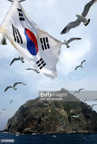 A South Korean national flag flutters aboard a tourship during a tour in the Koreancontrolled islands in the Sea of Japan known as Takeshima in Japan...