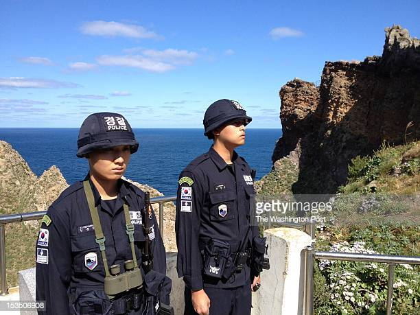 South Korean national police guard the islands in pairs positioned at various lookout points in South Korea on October 4 2012