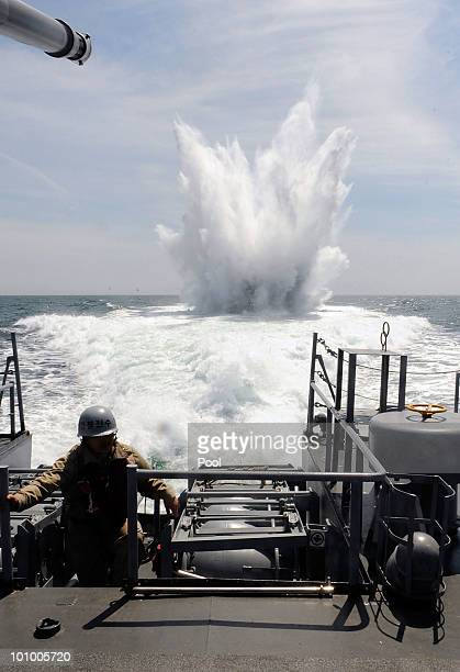 South Korean navy from Second Fleet Command soldiers drops an antisubmarine bomb in a drill targeting North Korean infiltration in seas off Taean on...