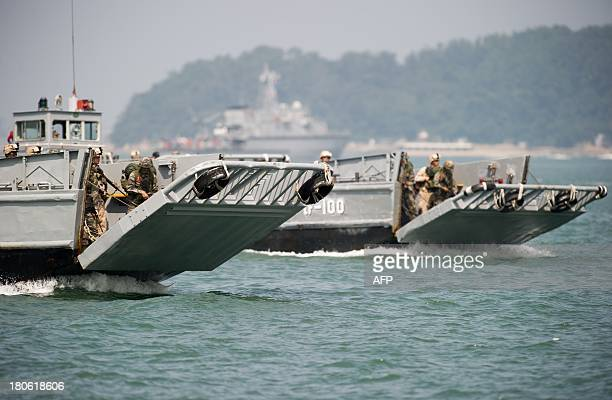 South Korean Navy landing crafts prepare to hit the beaches at Wolmi island at Incheon on September 15 2013 during a reenactment of the landing at...